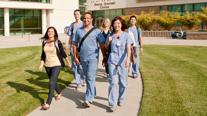 Residency students walking on pathway