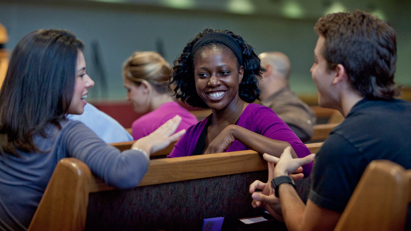 Students smiling in chapel