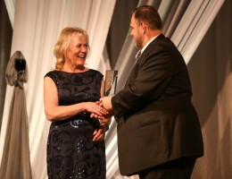 Scott Perryman, right, presents Helen Staples-Evans with the award for Outstanding Clinician.