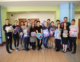 Dorothy Brooks, fifth from left, of child life services at LLU Children's Hospital, accepted handmade blankets from LLU School of Pharmacy students on Wednesday, March 14.