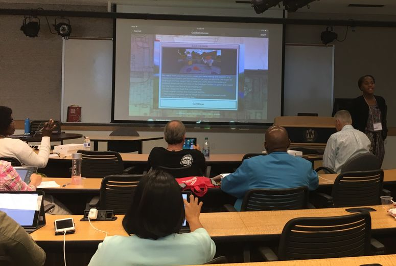 Attendees in digital classroom looking at screen
