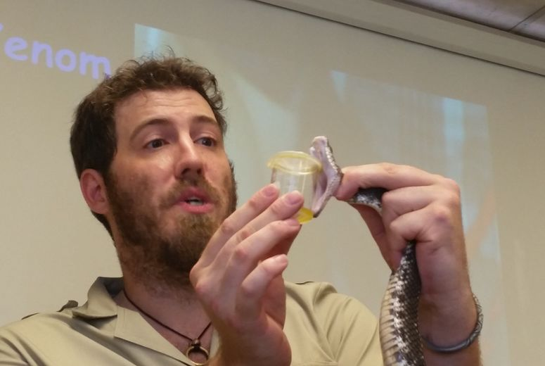 Attendee with snake