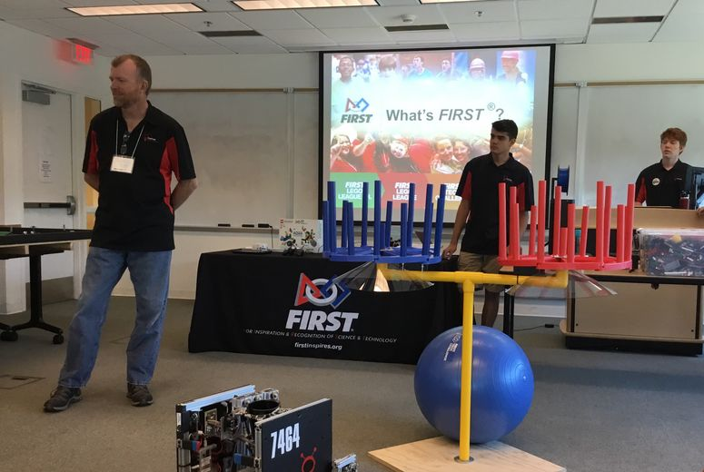 Attendees performing robotic exercises