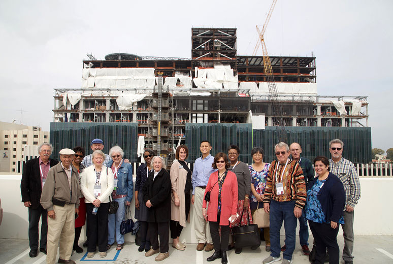 people in front of new construction of Loma Linda University Health hospital