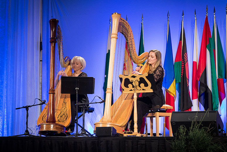 Photo of harpists playing