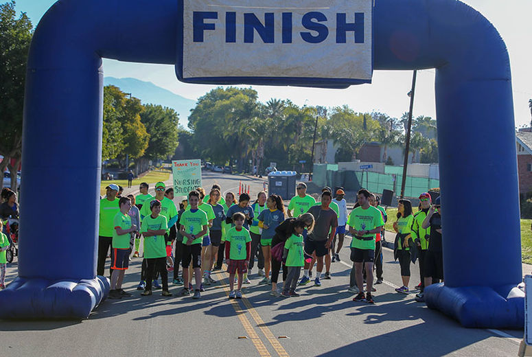 Photo of kids lining up at 5k start line