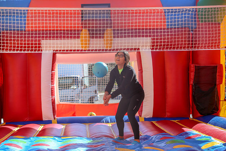 Photo of young child playing in bounce house