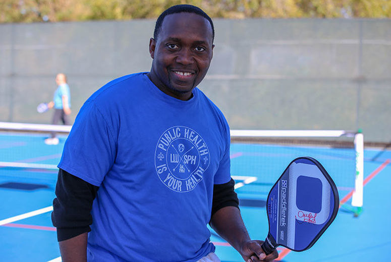 Photo of School of Public Health alumnus playing pickleball