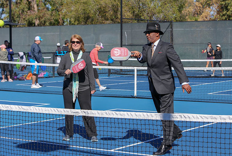 Photo of Dean Jackson of School of Allied Health playing pickleball