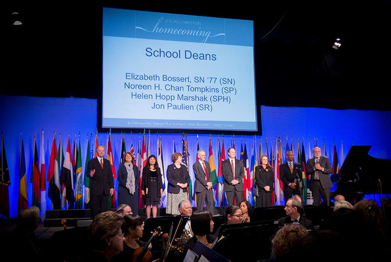 Photo of school deans being recognized on stage
