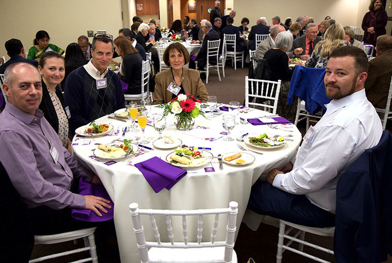 Photo of School of Public Health alumni eating at donor event