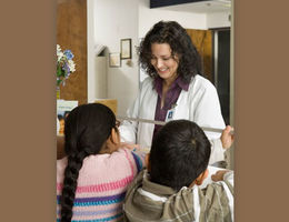 Nurse spending time with children