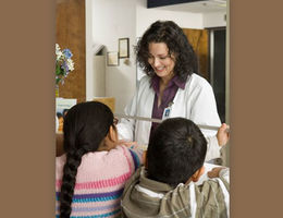 Nurse talking with children